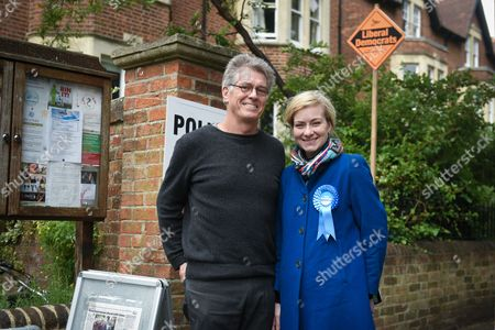 Nicola Blackwood, Conservative MP for Oxford West and Abingdon marginal seat, and her husband Paul Bate pose for a portrait outside the polling station in Oxford West and Abingdon