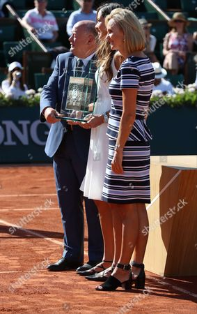 Former tennis champion Serbian Ana Ivanovic is receiving a trophy in her honor from the hands of WTA president Micky Lawler and French Tennis Federation Bernard Giudicelli