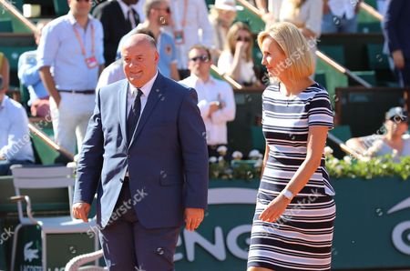 WTA president Micky Lawler and French Tennis Federation Bernard Giudicelli are entering the court for the ceremony in honor of Former tennis champion Serbian Ana Ivanovic