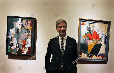 """Michael Govan, director Los Angeles Country Museum of Art, poses for a portrait during the inauguration of the exhibit titled """"Picasso and Rivera: Conversations through Time"""" inside the Fine Arts Palace in Mexico City, . The show is up through Sept. 10"""