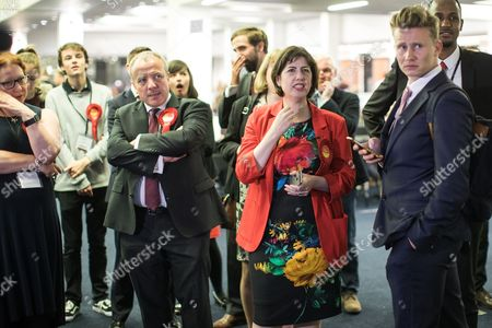 Stock Image of Mike Kane and Lucy Powell with fellow Labour Party supporters watch results come in on TV at the Manchester Central Convention Centre where the count for the constituencies of Blackley and Broughton, Manchester Central, Manchester Gorton, Manchester Withington and Wythenshawe and Sale East, in the General Election, is taking place.
