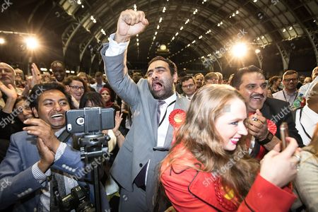 Crowd cheers as Afzal Khan is declared the winner in Manchester Gorton, beating George Galloway, who did not turn up for the declaration, at the Manchester Central Convention Centre where the count for the constituencies of Blackley and Broughton, Manchester Central, Manchester Gorton, Manchester Withington and Wythenshawe and Sale East, in the General Election, is taking place.