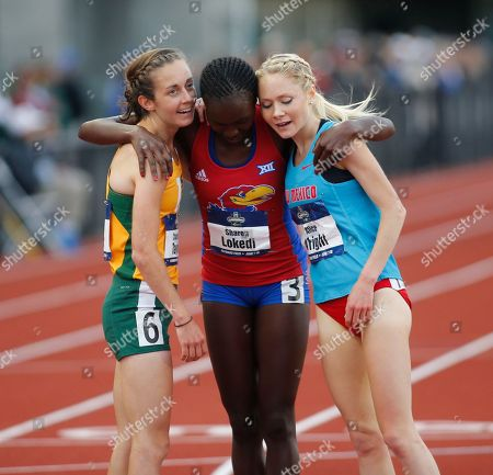 Charlotte Taylor, Sharon Lokedi, Alice Wright San Francisco's Charlotte Taylor, left, Kansas' Sharon Lokedi, center, and New Mexico's Alice Wright, right, embrace after finishing the women's 10,000 meters on the second day of the NCAA outdoor college track and field championships in Eugene, Ore., . Taylor won the race in 32 minutes, 38.57 seconds