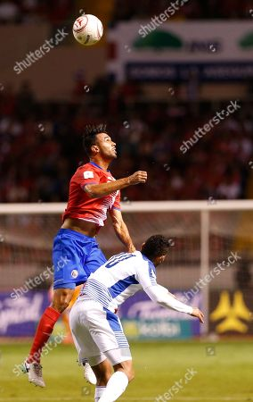 Costa Rica's Giancarlo Gonzalez heads the ball over Panama's Ismael Diaz during a 2018 Russia World Cup qualifying soccer match at the National stadium in San Jose, Costa Rica