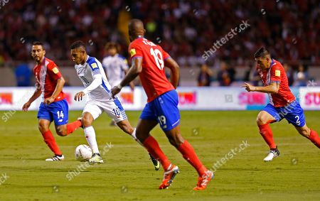 Panama's Ismael Diaz controls the ball during a 2018 Russia World Cup qualifying soccer match with Costa Rica at the National stadium in San Jose, Costa Rica, . Surrounding him are Costa Rica's Randall Azofeifa, behind left, Kendall Waston, front center, and Johnny Acosta, far right