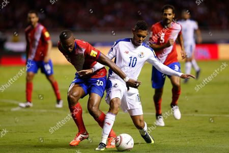 Costa Rica's Kendall Waston, front left, fights for the ball with Panama's Ismael Diaz during a 2018 Russia World Cup qualifying soccer match at the National stadium in San Jose, Costa Rica