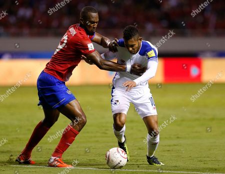 Costa Rica's Kendall Waston, left, pushes Panama's Ismael Diaz during a 2018 Russia World Cup qualifying soccer match at the National stadium in San Jose, Costa Rica