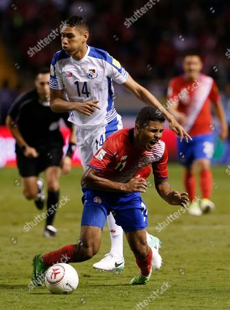 Costa Rica's Johan Venegas falls as he is fouled by Panama's Valentin Pimentel during a 2018 Russia World Cup qualifying soccer match at the National stadium in San Jose, Costa Rica, . Pimentel was given a yellow card following the play