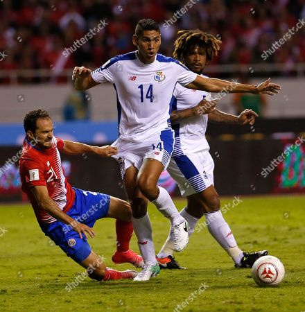 Costa Rica's Marco Urena pulls on the shorts of Panama's Valentin Pimentel during a 2018 Russia World Cup qualifying soccer match at the National stadium in San Jose, Costa Rica