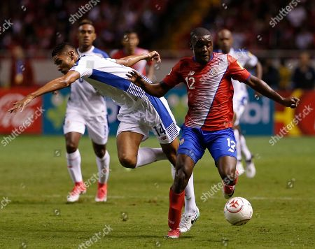 Costa Rica's Joel Campbell controls the ball as Panama's Valentin Pimentel falls behind during a 2018 Russia World Cup qualifying soccer match at the National stadium in San Jose, Costa Rica