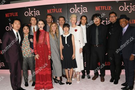 L-R: Steven Yeun, Christina Oh, Paul Dano, Lily Collins, Tara Subkoff, Erik Jan de Boer, Brad Pitt, Tilda Swinton, Jeremy Kleiner, Joon-ho Bong