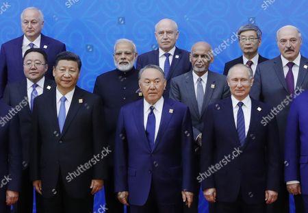 (Front L-R) Chinese President Xi Jinping, Kazakhstan's President Nursultan Nazarbayev, Russian President Vladimir Putin, (middle row, L-R) Mongolian President Tsakhiagiin Elbegdorj, Indian Prime Minister Narendra Modi, Afghan President Ashraf Ghani, Belarus President Alexander Lukashenko and other unidentified participants pose for a picture during the  Shanghai Cooperation Organization (SCO) summit in Astana, Kazakhstan, 09 June 2017. Astana hosts the SCO summit on June 08-09, 2017.