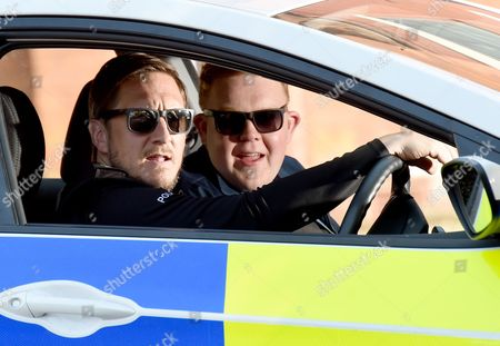 Colson Smith and Ben Cartwright do their best Blues Brothers impression between takes.
