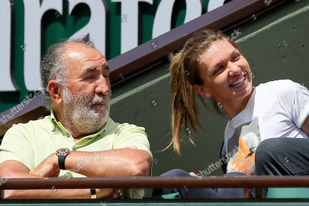 Romanian tennis legend Ion Tiriac and finalist Romania's Simona Halep watch Switzerland's Stan Wawrinka playing Britain's Andy Murray during their semifinal match of the French Open tennis tournament at the Roland Garros stadium, in Paris