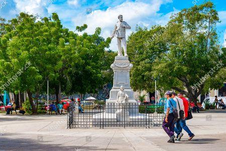 White marble Julio Grave de Peralta statue in Holguin