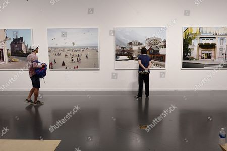 Stock Photo of Visitors look the work called 'France' by Raymond Depardon at the exhibition of the fondation Cartier at the Seoul Museum of Art in Seoul, Korea, 09 June 2017. The exhibition is running under the theme 'HIGHLIGHTS' from 30 May to 15 August 2017 in Seoul.