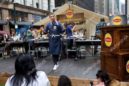 "Chef Bobby Flay hosts the ""Showdown at the Grill"" as part of Lipton Summer Camp, in New York. Culinary students competed to win prizes as they came up with original recipes made with Lipton Iced Tea. For more information and to learn how you could enter for a once-in-a-lifetime Food Network Star experience to dine with Bobby Flay visit www.liptonmeal.com"
