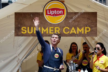 "Chef Bobby Flay turned ""head counselor"" demonstrates how to make delicious summer dishes using Lipton Iced Tea at Lipton Summer Camp, in New York. The event gave people a chance to re-live their favorite summertime memories right in Herald Square. For more information on the recipes and to learn how you could enter for a once-in-a-lifetime Food Network Star experience to dine with Bobby Flay visit www.liptonmeal.com"