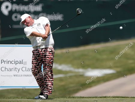 Mark Calcavecchia hits off the 18th tee during the first round of the PGA Tour Champions Principal Charity Classic golf tournament, in Des Moines, Iowa