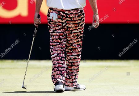 Mark Calcavecchia walks on the 18th green wearing his bacon themed pants during the first round of the PGA Tour Champions Principal Charity Classic golf tournament, in Des Moines, Iowa