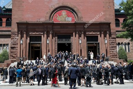 Stock Photo of Mourners gather out front after the funeral for Zbigniew Brzezinski, who was national security adviser to President Jimmy Carter, at the Cathedral of Saint Matthew the Apostle, in Washington