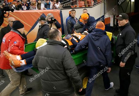 Graph, Denver Broncos linebacker Zaire Anderson is taken off the field with an injury during an NFL football game against the Oakland Raiders in Denver. Anderson is happy to be back on the gridiron after the injury left him unconscious for a short time