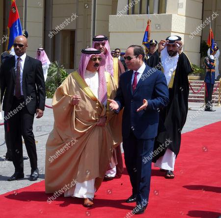Stock Photo of Egyptian President Abdel Fattah Sisi bids farewell to King of Bahrain Hamad bin Issa al-Khalifa at Cairo International Airport