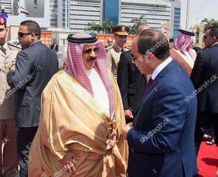 Stock Picture of Egyptian President Abdel Fattah Sisi bids farewell to King of Bahrain Hamad bin Issa al-Khalifa at Cairo International Airport