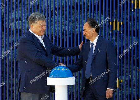 "Stock Picture of Petro Poroshenko, Hugues Mingarelli Ukrainian President Petro Poroshenko, left, and EU Ambassador to Ukraine Hugues Mingarelli start a symbolic ""visa-free timer"" at a ceremony marking the launch of a visa-free regime with the EU in Kiev, Ukraine, . The regulation on the EU visa liberalization for Ukrainian citizens was signed in Strasbourg on May 17. Ukraine's visa-free regime with the European Union will take effect on June 11"