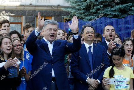 "Stock Image of Petro Poroshenko, Hugues Mingarelli Ukrainian President Petro Poroshenko, center left, and EU Ambassador to Ukraine Hugues Mingarelli, center right, take part in a symbolic start of ""visa-free timer"" at a ceremony marking the launch of a visa-free regime with the EU in Kiev, Ukraine, . The regulation on the EU visa liberalization for Ukrainian citizens was signed in Strasbourg on May 17. Ukraine's visa-free regime with the European Union will take effect on June 11"