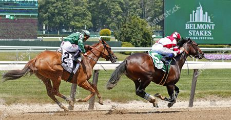 SONGBIRD (Mike Smith) beats PAID UP SUBSCRIBER (left) in The 49th running of The Ogden Phipps Stakes Belmont Park USA