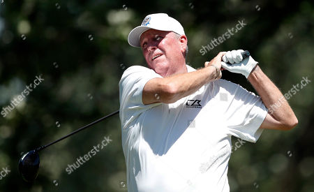 Mark Calcavecchia hits off the third tee during the second round of the PGA Tour Champions Principal Charity Classic golf tournament, in Des Moines, Iowa