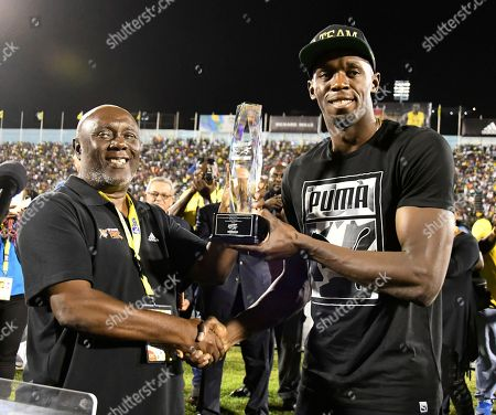 "Usain Bolt, Glen Mills Jamaica's Usain Bolt receives a special award from his coach, Glen Mills, before competing in the ""Salute to a Legend"" 100 meters during the Racers Grand Prix at the national stadium in Kingston, Jamaica, . Bolted start his final season with his last race on Jamaican soil and plans to retire from track and field after the 2017 London World Championships in August"
