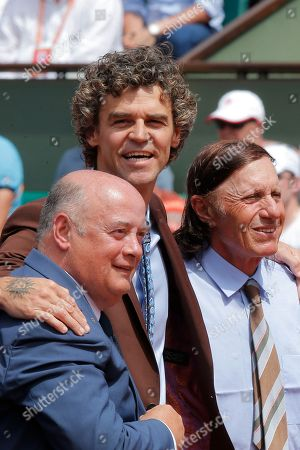 Former Brazilian tennis ace Gustavo Kuerten poses with French Tennis Federation president Bernard Giudicelli and former Romanian champion Ilie Nastase gather before Spain's Rafael Nadal plays Switzerland's Stan Wawrinka in their final match of the French Open tennis tournament at the Roland Garros stadium, in Paris