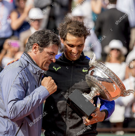 Rafael Nadal celebrates his French Open victory with the Coupe des Mousquetaires and his Uncle and coach Toni Nadal
