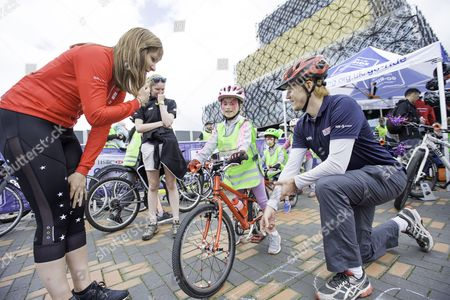 Joanna Rowsell Shand helps out young riders with their bikes and skills