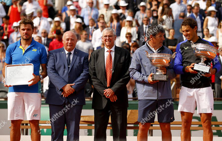 Uncle Toni Nadal stands next to Rafael Nadal with the La Decima trophy along with Stan Wawrinka following the Mens Final