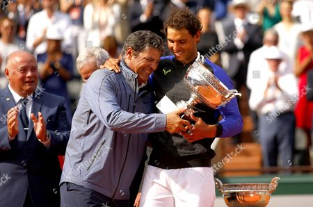 Rafael Nadal of Spain celebrates with Uncle Toni Nadal and the trophy during the Mens Final