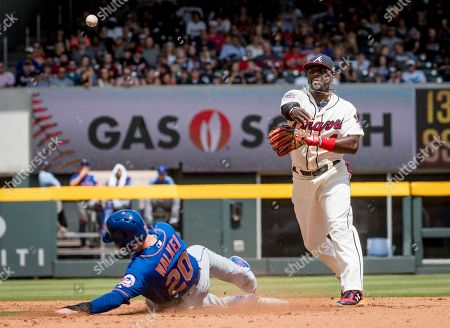 Brandon Phillips, Neil Walker Atlanta Braves second baseman Brandon Phillips throws over the head of New York Mets' Neil Walker (20) as he slides to second base for a double play as he gets out shortstop Asdrubal Cabrera at first base during the sixth inning of a baseball game, in Atlanta