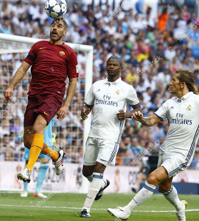Stock Picture of Former Roma´s midfielder Simone Perrotta (L) in action against Real Madrid´s Juliio Cesar (C) and Michel Salgado (R) during the Corazon Classic Match 2017 'Heartbeats for Africa' between legends of Real Madrid and Roma played at Santiago Bernabeu Stadium in Madrid, Spain, 11 June 2017.