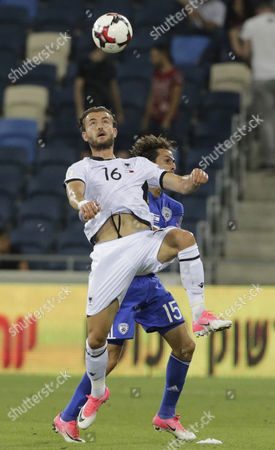 Edgar Cani  (L) of Albania fights for the ball with Israel's Yossi Benayoun during the FIFA World Cup 2018 qualification match between Israel and Albania at the Sami Ofer stadium, Haifa, Israel, 11 June 2017.