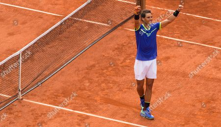 Stock Photo of Spain's Rafael Nadal Celebrates after he  beats Stanislav Wawrinka in straight sets to win his 10th French Open Singles Title