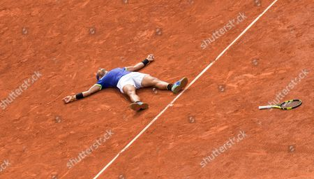 Spain's Rafael Nadal Celebrates match point as he beats Stanislav Wawrinka in straight sets to win his 10th French Open Singles Title
