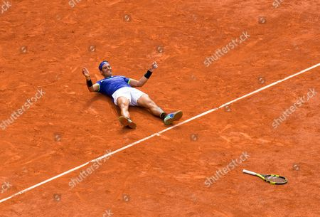 Stock Picture of Spain's Rafael Nadal Celebrates match point as he beats Stanislav Wawrinka in straight sets to win his 10th French Open Singles Title