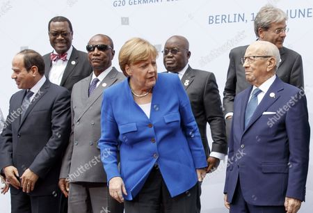 (L-R) Egyptian President Abdelfattah Al-Sisi, President of the African Development Bank Akinwumi Adesina, President of the Republic Mali Ibrahim Boubacar Keita, German Chancellor Angela Merkel, President of the Republic Ghana Nana Addo Dankwa Akufo-Addo, Tunesian President Beji Caid Essebsi and Italian Prime Minister Paolo Gentiloni pose for a group picture before the opening of the 'International Conference G20 Africa Partnership' in Berlin, Germany, 12 June 2017. The conference is to suppor private investment, sustainable infrastructure and employment in African countries.