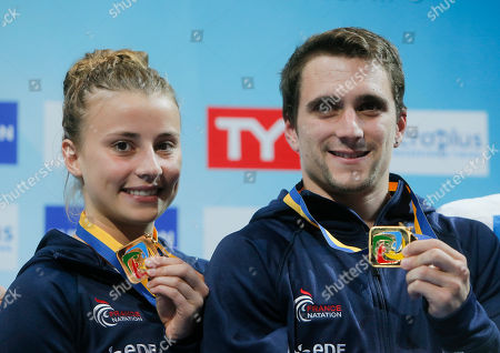Matthieu Rosset, Laura Marino French divers Matthieu Rosset, right, and Laura Marino hold up their gold medals after winning Team Event Final during European Diving Championship in Kiev, Ukraine