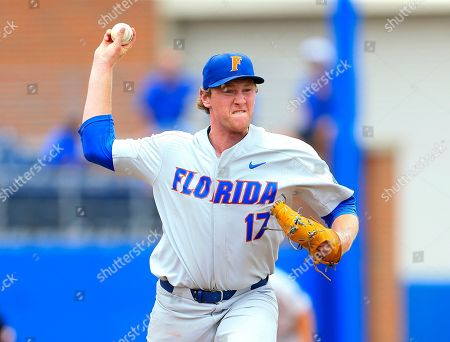 Florida pitcher Michael Byrne (17) throws to first on a pick-off attempt during an NCAA college super regional baseball game against Wake Forest, in Gainesville, Fla