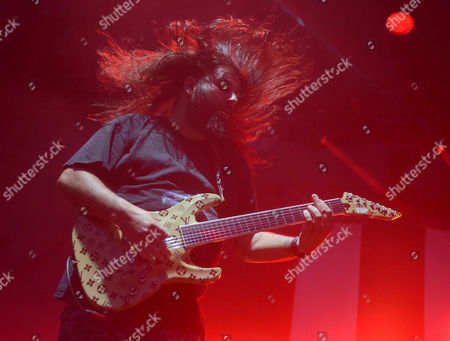 Guitarist Stephen Carpenter of the band Deftones performs at Huntington Bank Pavilion at Northerly Island in Chicago, Illinois