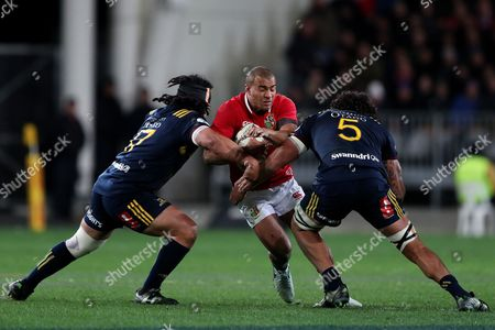 Stock Photo of Jonathan Joseph is tackled by Aki Seiuli and Jack Hemopo