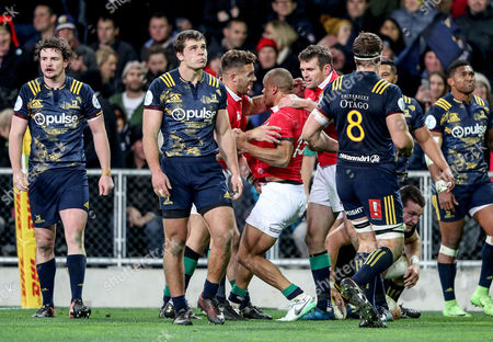 Highlanders vs British & Irish Lions. Lions' Jonathan Joseph is congratulated by Rhys Webb and Jared Payne after scoring a try